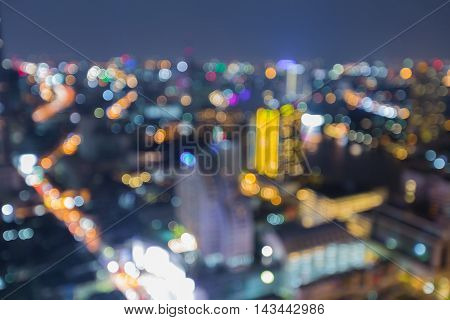Blurred bokeh lights aerial view city downtown, abstract background