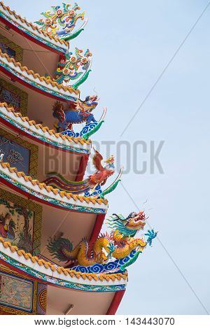 Traditional Chinese roof with chinese animal including dragon swan and kirin (dragon-headed unicorn).