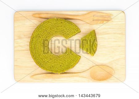 Multiple layers green tea cake on wooden board