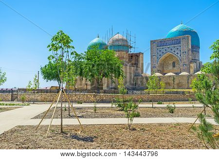 The medieval religious complex of Dorut Tilavat with the bright blue dome of the Cathedral Kok Gumbaz Mosque Shakhrisabz Uzbekistan.