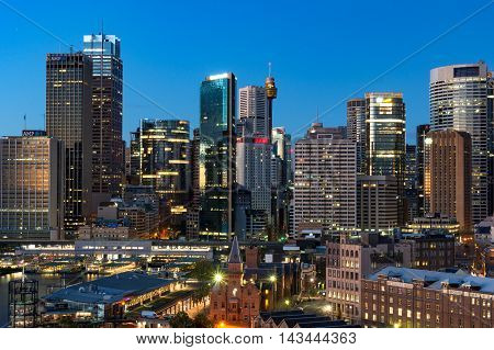 Sydney Australia - Jul 23 2016: Central Business District cityscape skyline with skyscrapers of office buildings and Circular Quay ferry and train station. Urban scene with modern architecture