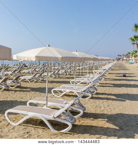 Line of sun beds and Umbrellas on a Larnaca beach in Cyprus
