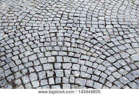 Old cobblestones road surface (Albanian sidewalk) background