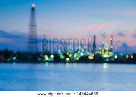 Blurred lights Oil refinery river front during sunrise