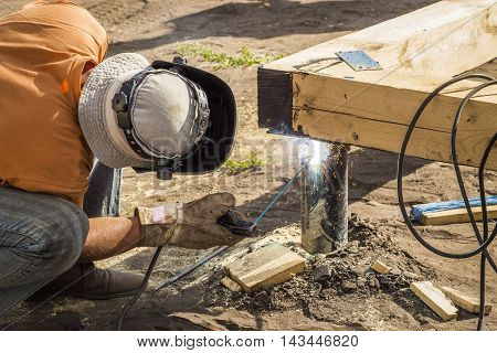 Welder at work in the open construction site