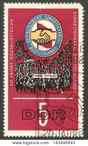 MOSCOW RUSSIA - CIRCA JULY 2016: a stamp printed in DDR shows Insignia of the Socialist Unity Party the series