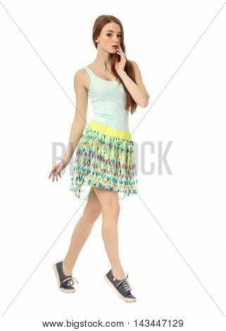 Young fashion girl in skirt posing isolated