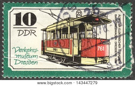 MOSCOW RUSSIA - CIRCA JUNE 2016: a post stamp printed in DDR shows a Electric streetcar motor coach the series