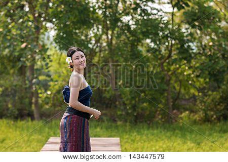 Beautiful woman new generation woman lao in native dress at Pakse South Laos.