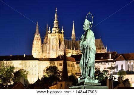 Statue of St. John of Nepomuk on the Charles bridge in PragueCzech Republic night scene