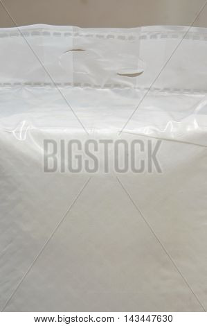 incontinence pads in clear plastic bag packaging