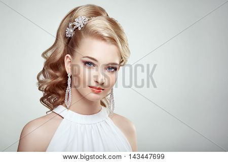 Fashion Portrait Of Young Beautiful Woman With Jewelry And Elegant Hairstyle