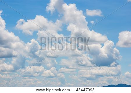 Abstract white cloudy and blue sky in sunny day. Fantastic sky and clouds texture background.