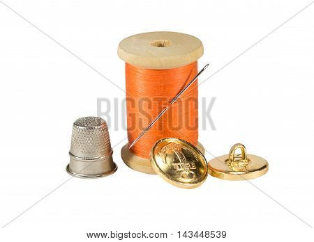 Spool of thread needle button and thimble isolated on white