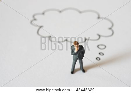 Image of Thinking businessman with speech bubbles .