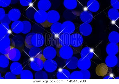 Abstract bokeh background of Christmas light on bright colors style.