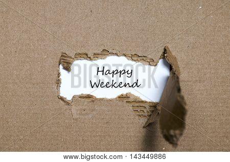 The words happy weekend appearing behind torn paper