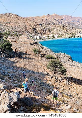 Rhodes, Greece- June 22, 2016. Path by the sea, from Maridaki to Tsoutsouros beach. South Heraklion. Crete. Greece. The beach of Tsoutsouros can be seen.