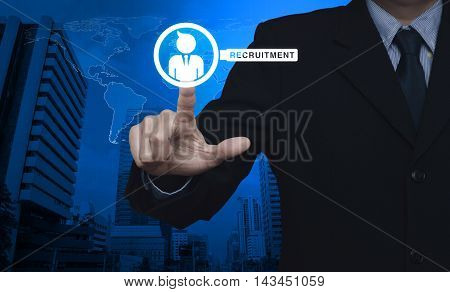 Hand pressing businessman with magnifying glass icon over map and city tower Recruitment concept Elements of this image furnished by NASA