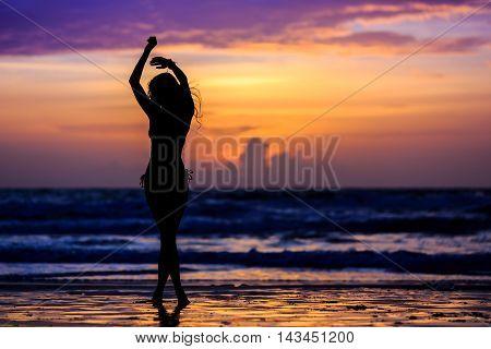 Silhouette Young Woman. Dancing