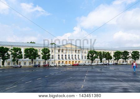 YAROSLAVL RUSSIA - JULY 21 2016: Unknown woman goes on Sovetskaya square near building of former Provincial official places Yaroslavl Russia