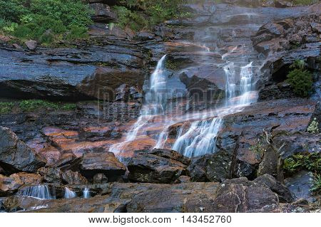 Wentworth Falls lower section waterfall cascade. Water flowing over rocks. Wentworth Falls Blue Mountains National Park Australia