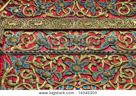 Ornate decoration of goldleaf and tiles from a Thai temple