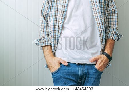 Casual handsome man wearing jeans and plaid shirt with clean white t-shirt as copy space for graphic design print mock up