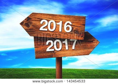 2016 and 2017 crossroads direction signs aginst blue sky