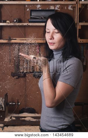 Girl-carpenter In The Workshop,