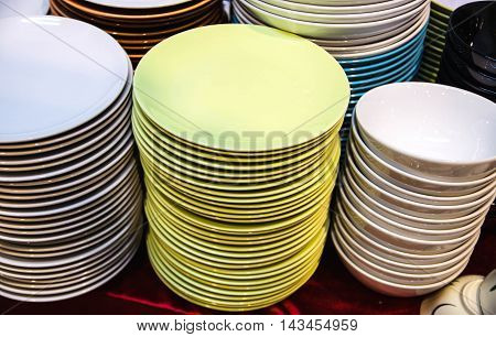 stack of colorful plate made of ceramic