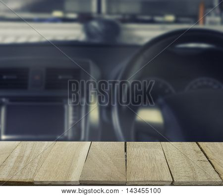 wood table top on blur background of inside car - can use to display or montage product