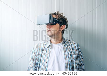 Guy with VR goggles exploring virtual reality environment