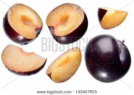 Sliced plums and segments isolated on white