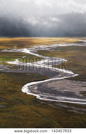 Aerial view landscape of river lines with foggy environment and sunlight in the morning, in Indonesia