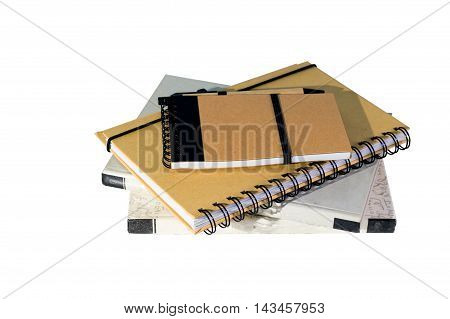 stack of books with brown notebook isolated on white background