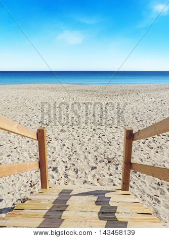 wooden steps of a rescue tower at the beach with view to the blue sea and white sand. Beach background.