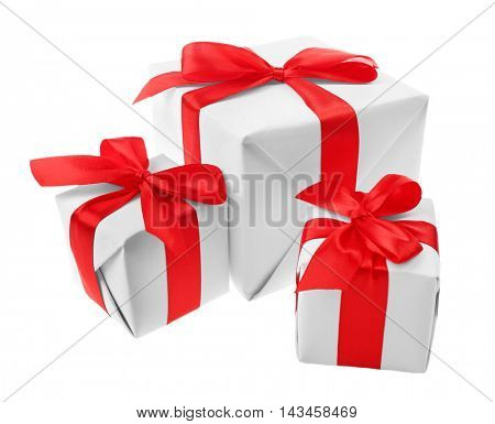Gift boxes with red ribbon isolated on white