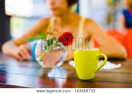 Girl Drinking Cappuccino.
