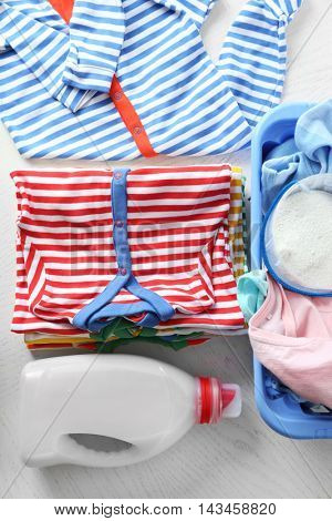 Clothes with detergent in plastic basket