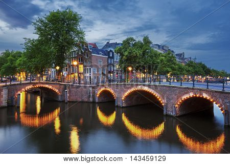 View of Amsterdam Canal and Light by night