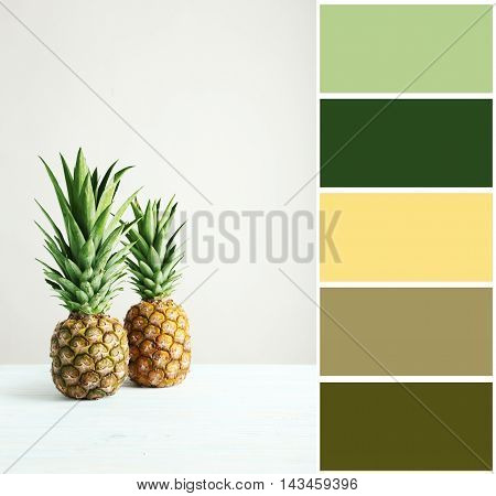 Ripe Pineapples On A White Wooden Table With Color Palette