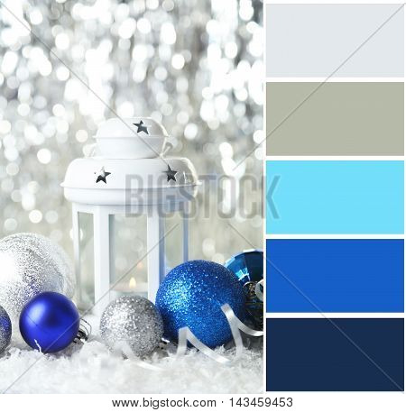 Candlestick with christmas ball on lights background with color palette