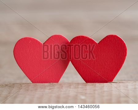 Couple of red hearts on wood floor. Love and Valentine concept. Happy Valentine's day.