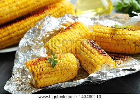 Tasty Grilled Corn On Grey Wooden Table