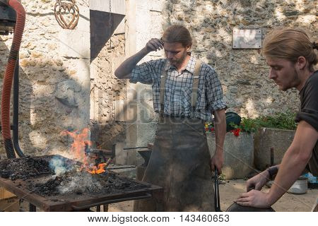 Demonstration By Two Blacksmiths Labor Metal To The Old Way