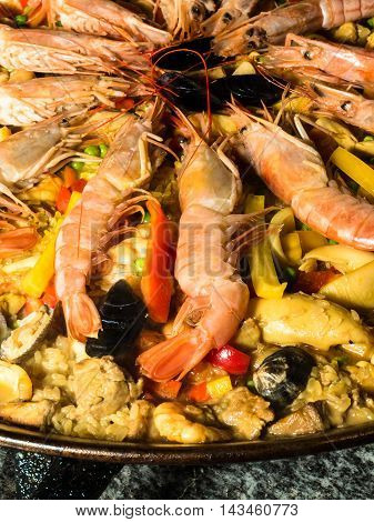 A typical rice dish called Paella with shrimps and shellfish
