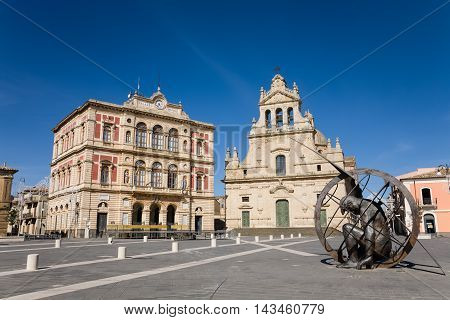 Grammichele Italy - 2015 May 1 : The main square of the Sicilian town of Grammichele with town hall mother church and sundial near Catania Sicily Italy