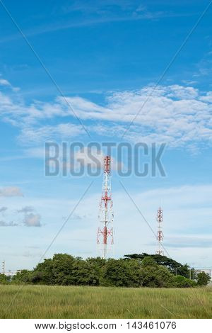 Two telecommunications tower with blue sky background