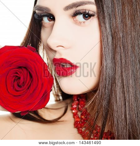 Portrait of a Beautiful Woman with Fashion Makeup and Red Rose Flowers